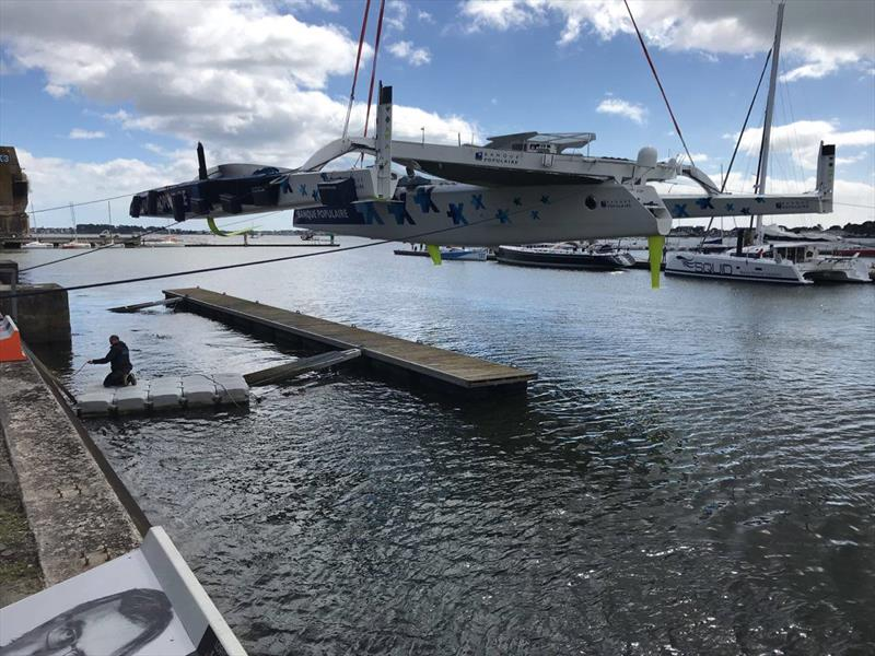 Exit building shed and first splash Maxi Banque Populaire IX. Skipper, Armal Le Cleac'h. - photo © Team Banque Populaire IX