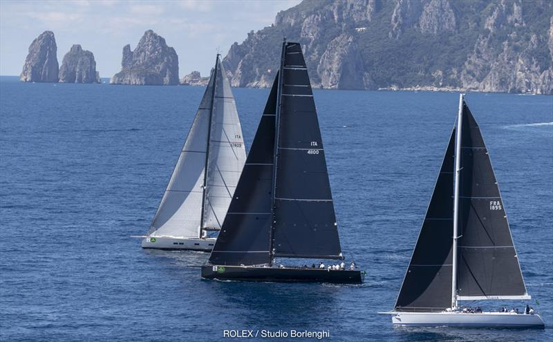Conditions turned light then died as the Maxis ventured out beyond - here showing the famous Faraglioni rocks in the distance - 2018 Rolex Capri Sailing Week photo copyright Carlo Borlenghi taken at Yacht Club Capri and featuring the Maxi class