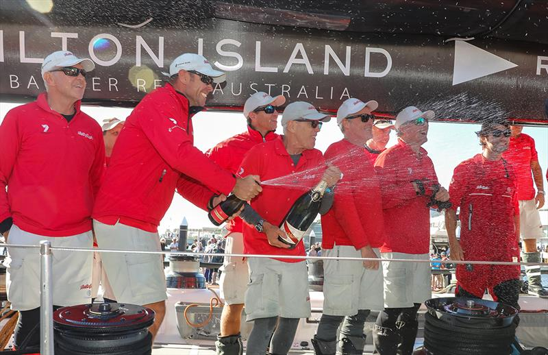 The champagne flows aboard Wild Oats XI - photo © Crosbie Lorimer