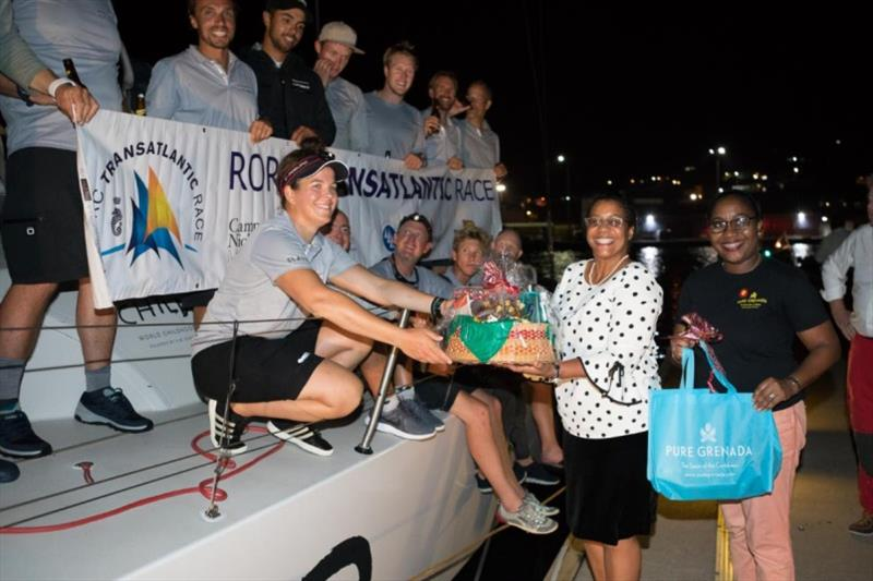 A fantastic welcome dockside in Grenada from Nikoyan Roberts on behalf of the Grenada Tourism Authority and Charlotte Bonin, Camper & Nicholsons Port Louis Marina Manager - photo © RORC / Arthur Daniel
