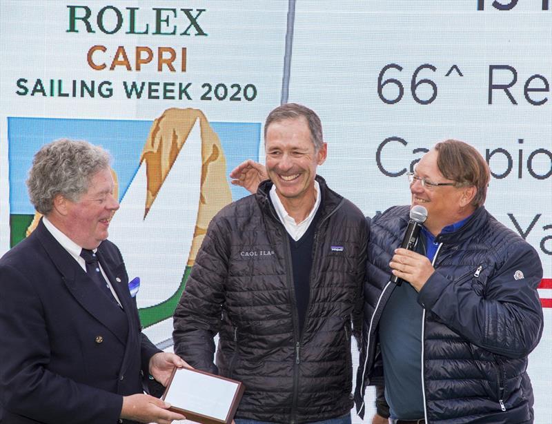 Alex Schaerer and Francesco de Angelis are presented with a 2019 Rolex Capri Sailing Week trophy by IMA Secretary General Andrew McIrvine. - photo © Studio Borlenghi / International Maxi Association