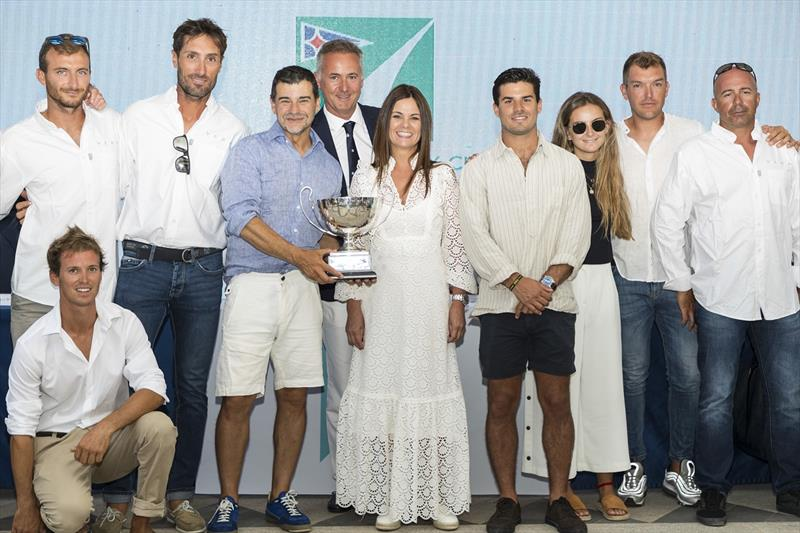 IMA Mediterranean Maxi Offshore Challenge winner in 2018-19 was Vera, owned by Argentina's Miguel Galuccio, seen here with his crew & family after being presented with silver trophy by IMA President Benoît de Froidmont at Maxi Yacht Rolex Cup prizegiving. - photo © Studio Borlenghi / International Maxi Association