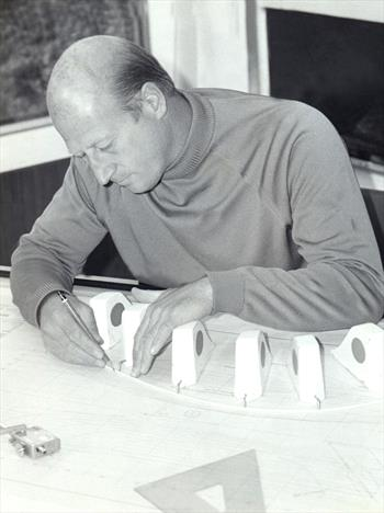 Peter Milne at work at his drawing board. A busy and successful designer of both yachts and dinghies, it is easy to think of him just in terms of the Fireball. But his designs ranged over many disciplines - photo © PPL Picture Library