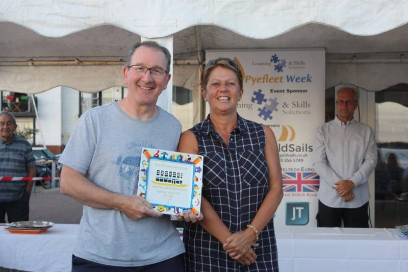 Pete Purkiss claims his RS700 prize from Sue Bouckley of Learning & Skills Solutions at Learning & Skills Solutions Pyefleet Week - photo © Mandy Bines