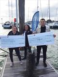 Maxine Lane, Senior Marketing Manager at MDL Marinas, presenting cheques to Jacob Kean Hammerson from Blue Marine Foundation and Peta Koczy (Staff Skipper) from Ocean Youth Trust (South) at Port Hamble Marina.