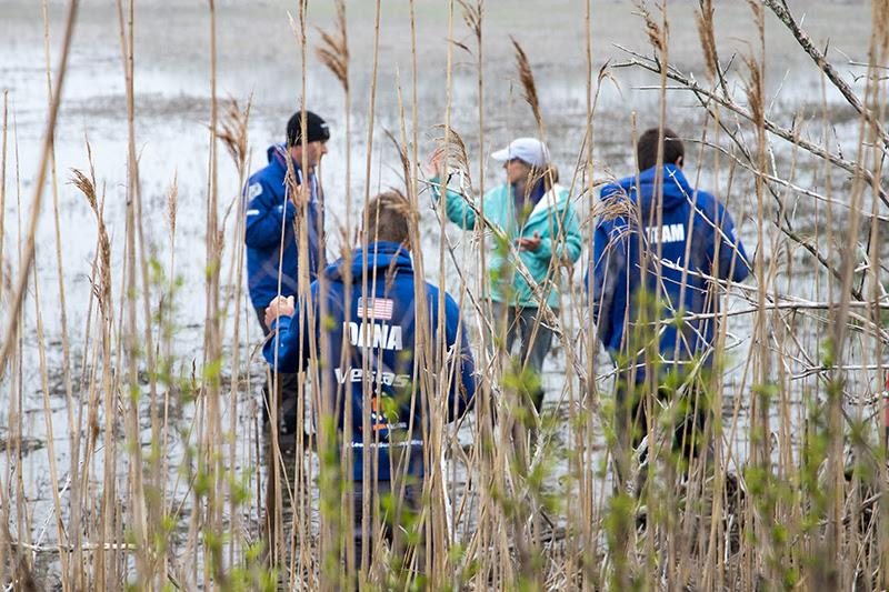 Sailors from Vestas 11th Hour Racing head into the marsh with Wenley Ferguson, Director of Habitat Restoration at Save The Bay to learn about restoration and help dig runnels so water can flow off the marsh. - photo © Harbor Beacon