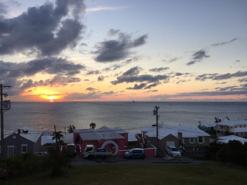 The view from the inshore end of the finish line at St. David's Lighthouse at dawn, on Wednesday. The finish line, with a series of boats approaching, is just to the right of the telephone pole photo copyright John Burnham taken at Royal Bermuda Yacht Club