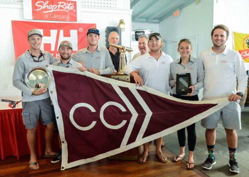 "College of Charleston posing next to Paul Hoffmann Trophy for Best Overall Performance. Standing behind them are Peter Becker (L, representing Young American Sailing Academy, owner of J/105 that Charleston raced), and Paul ""Binky"" Hoffman, Jr. on right - photo © Maureen Koeppel"
