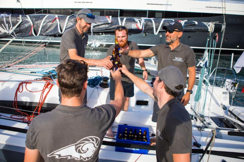 Enjoying ice cold beers on arrival, courtesy of C&N Port Louis Marina - 2018 RORC Transatlantic Race - photo © RORC / Arthur Daniel
