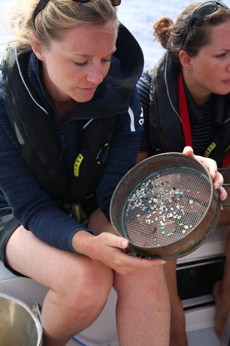 While sailing from Hawaii to Vancouver, the eXXpedition crew used a trawl to sample the ocean for microplastics. Pictured here, eXXpedition co-founder Emily Penn shows microplastics found in the trawl. - photo © Eleanor Church / Lark Rise Pictures
