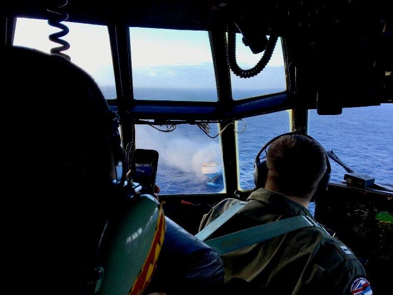 A Coast Guard HC-130 Hercules aircrew flies over the 650-foot Sincerity Ace on fire 1,800 nautical miles northwest of Oahu in the Pacific Ocean, Dec. 31, 2018. - photo © U.S. Coast Guard / HC-130 Hercules 1720