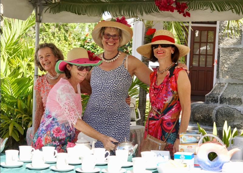 A bevy of volunteers dressed in blooming hats and garden dresses - Antigua Classic Yacht Regatta 2019 - photo © Jan Hein