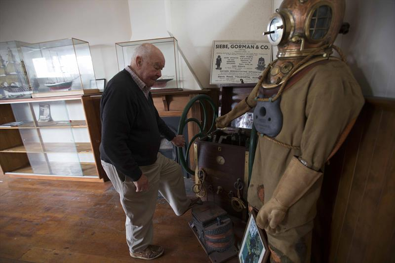 John Street looks over a deep sea diving suit used in a lot of salvage and other underwater tasks photo copyright NZ Maritime Museum taken at