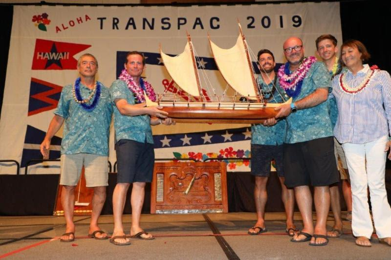 The crew of overall winners on Hamachi posing with the new King Kalakaua Trophy with trophy artist Ka'ili Chun (right) - Transpac 50 - photo © Sharon Green / Ultimate Sailing