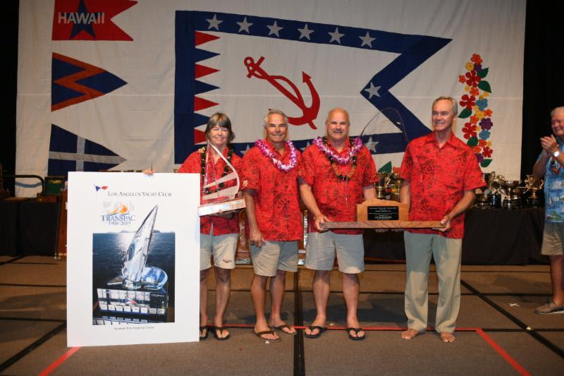 The crew of the Eddy family's Cal 40 Callisto accepting their awards in Division 10 - Transpac 50 - photo © Walt Cooper / Ultimate Sailing