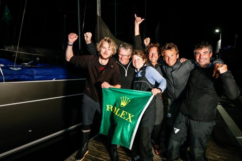The crew of Foggy Dew celebrate the end of a successful race. Noel Racine's fourth class win out of eight Fastnets. - 2019 Rolex Fastnet Race photo copyright Paul Wyeth / www.pwpictures.com taken at Royal Ocean Racing Club