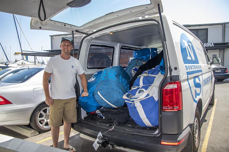 Billy Sykes unloading some of the 100 new or serviced sails that North Sails have to deliver in the week just past. - photo © John Curnow