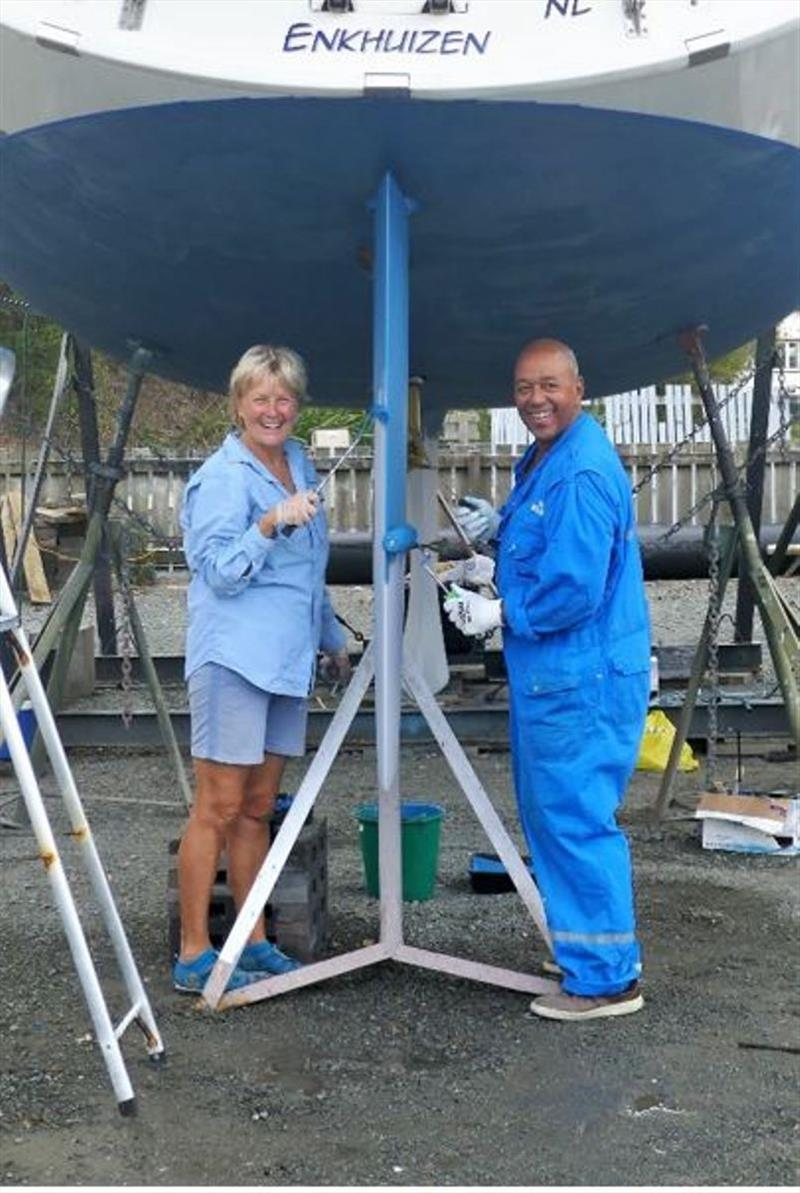 Martin and Ellen are working together to paint the underside of their Bavaria 45, Acapella. - photo © Lisa Benckhuysen