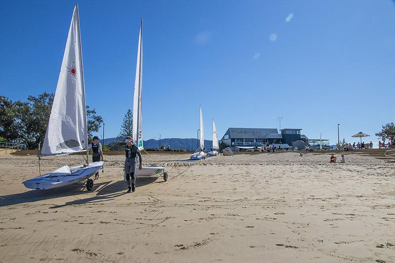 The AST Laser Squad take the very short stroll down to the beach form the Coffs Harbour Yacht Club. - photo © John Curnow