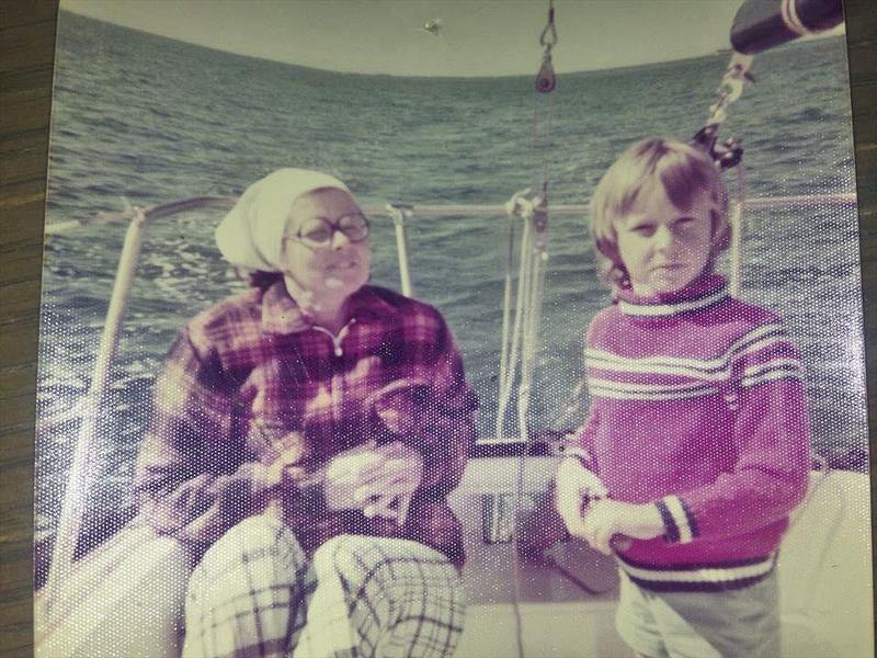 Mum and I sailing our family boat, age 6  - photo © Adrian Finglas