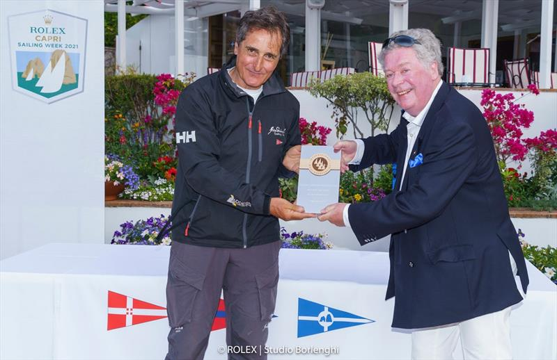 Fra Diavolo owner Vincenzo Addessi receives the prize for winning the Maxi Yacht Capri Trophy from International Maxi Associatino Secretary General Andrew McIrvine - photo © ROLEX / Studio Borlenghi