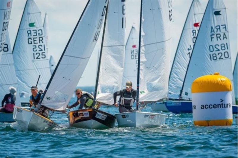 Close battles at the windward mark during the first race of OK European Championship.  - photo © Kiel Week / Sascha Klahn