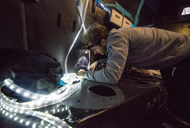 Flexible LED light strings aid repair work in the black carbon created darkness below decks- Hugo Boss - Keel and boat repairs following TJV incident - November 4, 2019 - Canary Islands photo copyright Alex Thomson Racing taken at  and featuring the IMOCA class