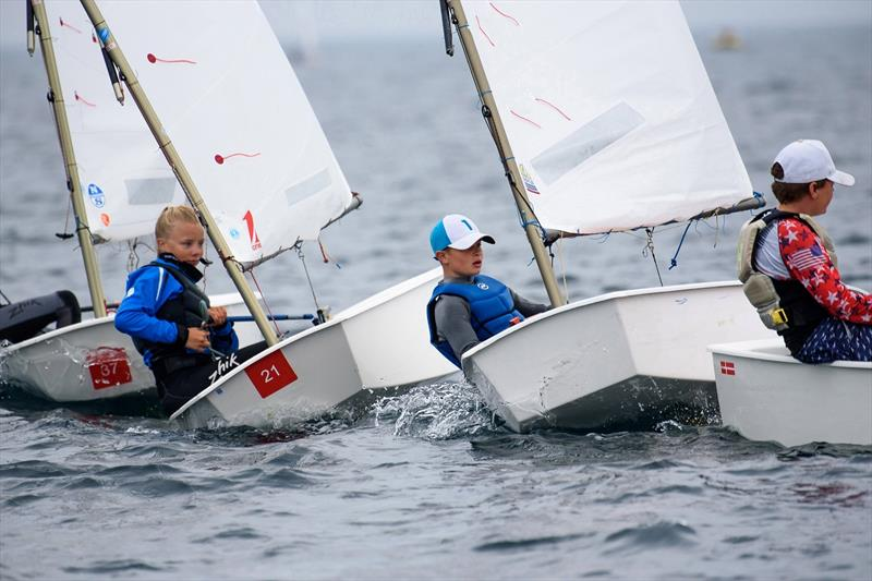 A tight squeeze competitors squeeze in on starboard during the AIB Irish Optimost Championship at the Royal Cork Yacht Club - photo © Bob Bateman