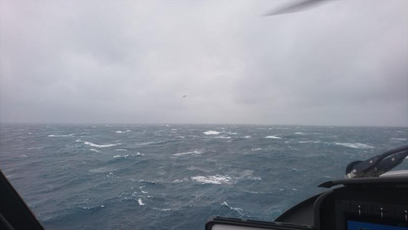 A P3 Orion from the Royal New Zealand Air Force was the first aircraft on the scene and remarkably was able to drop and position a liferaft close to the four sailors in the swimming in water - photo © Auckland Rescue Helicopter Trust