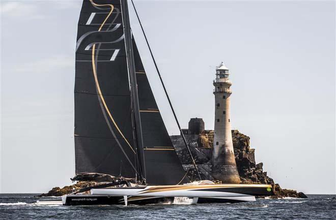 SPINDRIFT 2 rounds the Fastnet Rock at 14.03 BST on Monday afternoon - 2013 Rolex Fastnet Race ©  Rolex/Daniel Forster http://www.regattanews.com