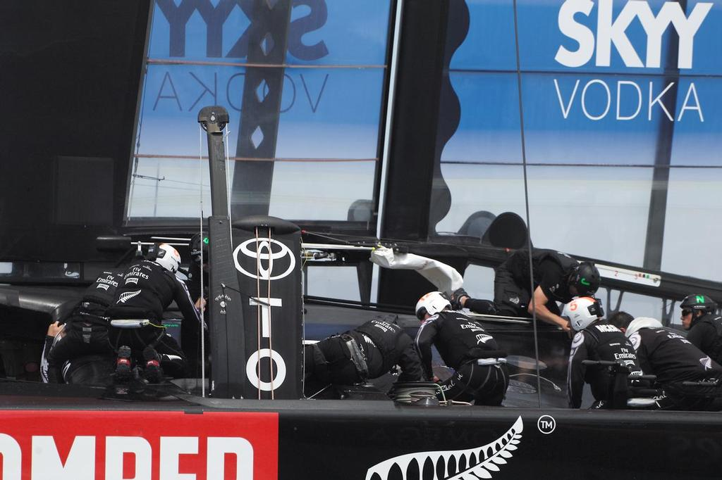 ETNZ crew checking damage to trampoline and front cross-member - Louis Vuitton Cup Final - Race 1 © Chuck Lantz http://www.ChuckLantz.com