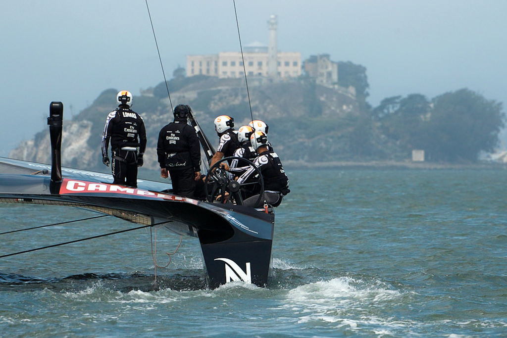 ETNZ crew moves towards the starting area, and the fog, with Alcatraz in the background. - America's Cup © Chuck Lantz http://www.ChuckLantz.com