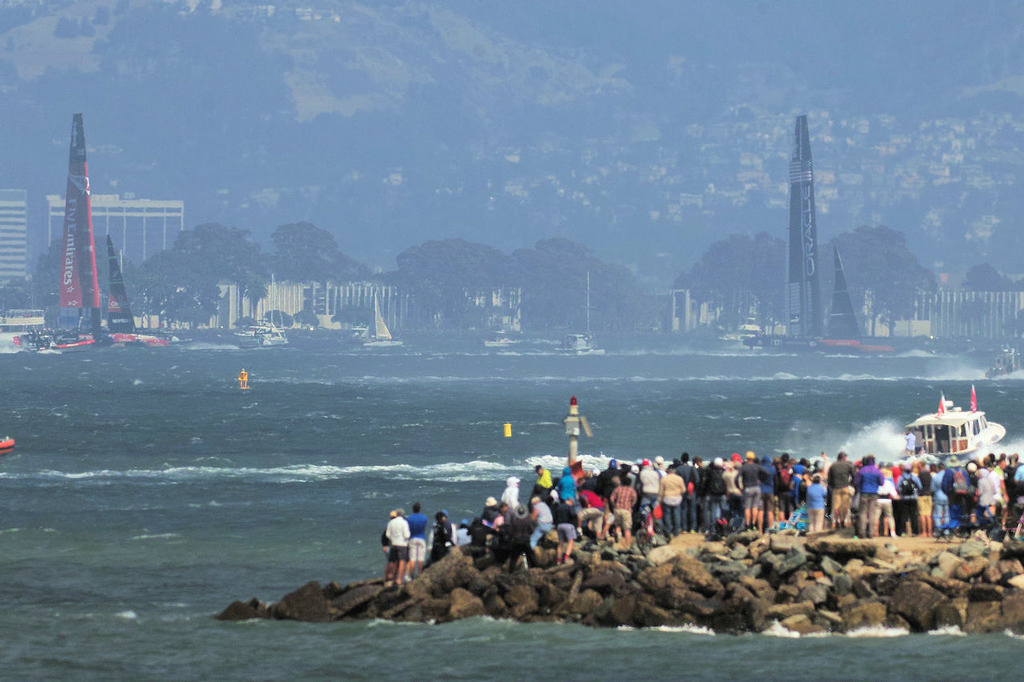 Fans on the rock jetty watch Oracle winning race four. - America's Cup © Chuck Lantz http://www.ChuckLantz.com