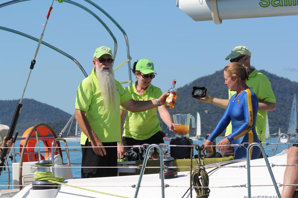 John Clinton blending drinks aboard Holy Cow supervised by Kim (in blue) - Abell Point Marina Airlie Beach Race Week 2013 © Sail-World.com http://www.sail-world.com