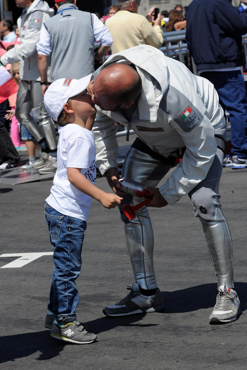 Skipper Max Sirena gives his son Lorenzo, 4, a kiss good-bye before going out to sail in the Louis Vuitton Cup on August 21, 2013 in San Francisco California. ©  SW