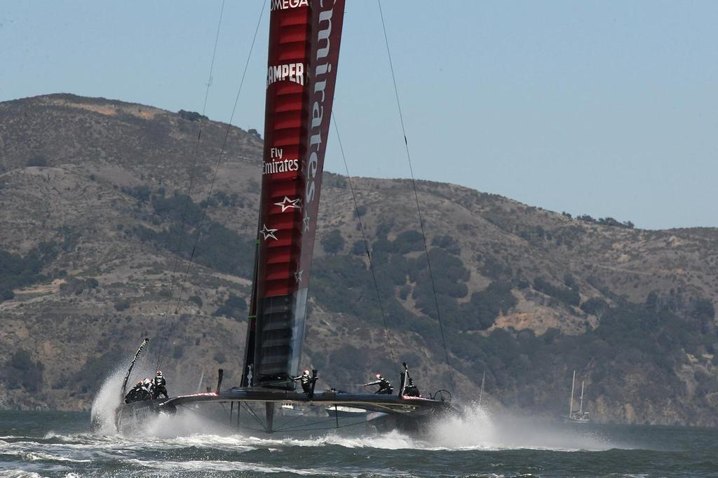 Emirates Team New Zealand flies to leeward and then to the finish to win the 7th match race of the Louis Vuitton Cup final on August 24, 2013 in San Francisco, California.  ©  SW
