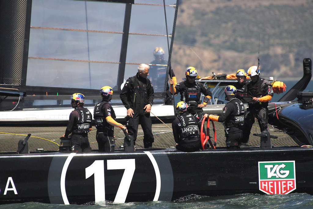 Before practice, the Oracle team goes over the details. - America's Cup © Chuck Lantz http://www.ChuckLantz.com