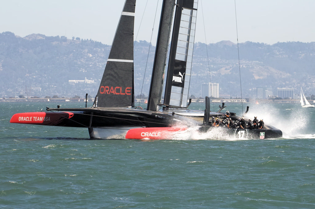 Oracle splashes down after their high-speed runs.  - America's Cup © Chuck Lantz http://www.ChuckLantz.com