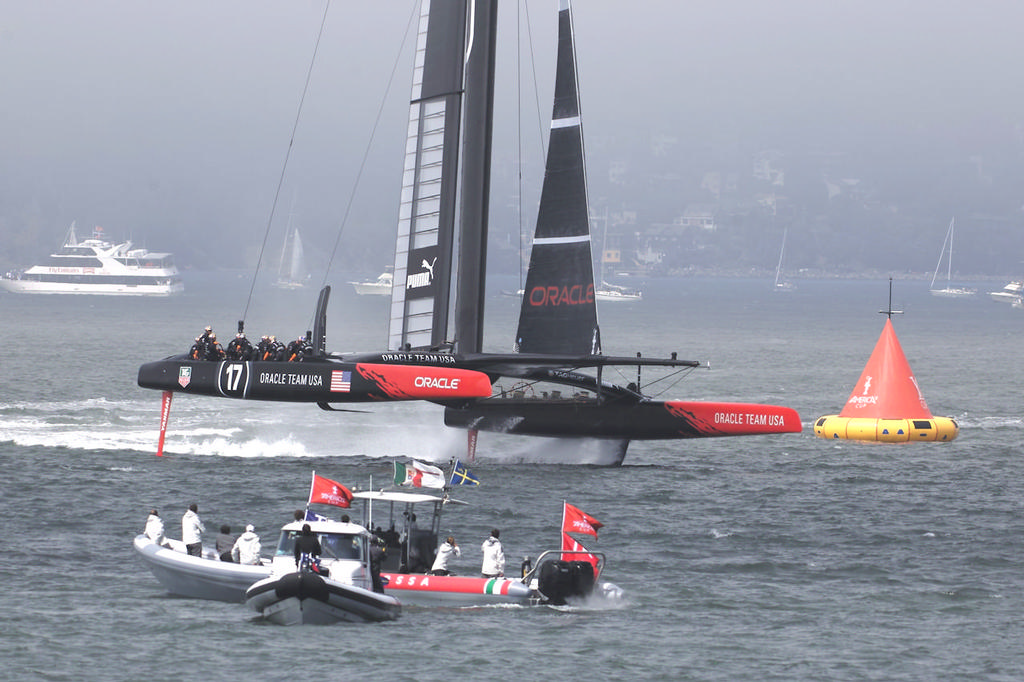 Luna Rossa support boat watches Oracle in the finals.  - America's Cup © Chuck Lantz http://www.ChuckLantz.com