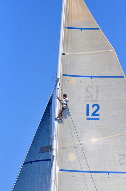 A sailor climbing the mast of one of the participating yachts during last year's 12 Metre North Americans in Newport, R.I. © SallyAnne Santos