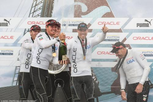 Members from one of the two Oracle Team USA teams sailing in the America's Cup World Series Naples 2013 - celebrate their success after the Final Race Day © ACEA - Photo Gilles Martin-Raget http://photo.americascup.com/
