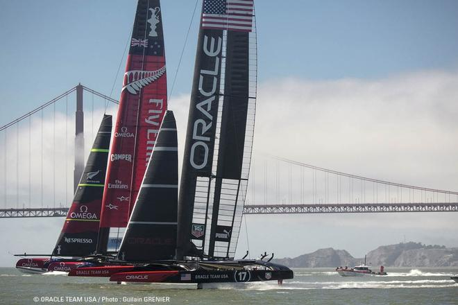 Oracle team USA and Emirates team NewZealand in action © Oracle Team USA http://www.oracleteamusa.com