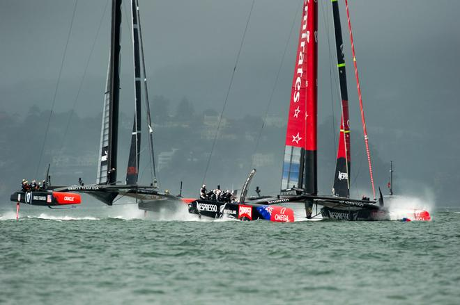 Emirates Team New Zealand and Oracle Team USA in the restart for race 13. The 1st attempt was called off after the 40 minute time limit was reached. America's Cup 34. 20/9/2013 © Chris Cameron/ETNZ http://www.chriscameron.co.nz