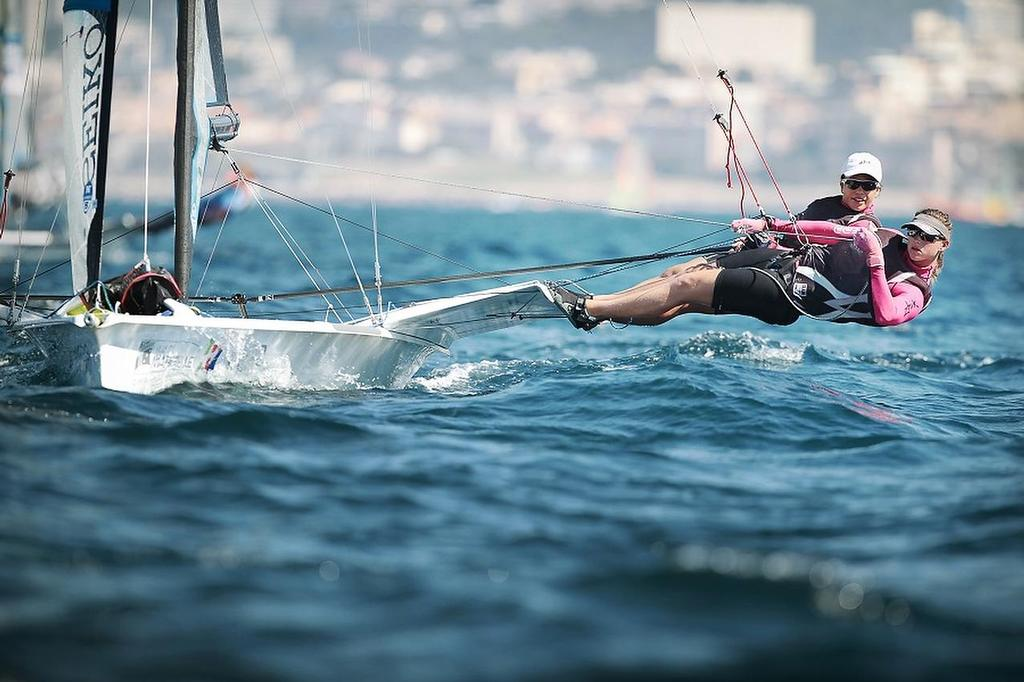 Alex Maloney and Molly Meech practicing ahead of their win in the 2013 49erFX World Championships © SW