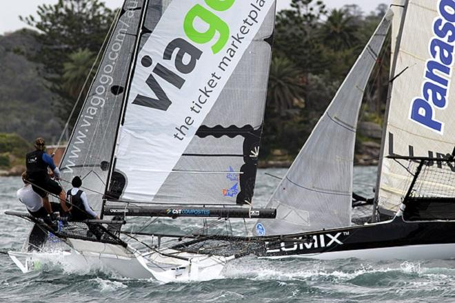 Viagogo rolls over the top of Lumix after the first mark rounding - Race 1, 2013 NSW 18ft Skiff Championship © Frank Quealey /Australian 18 Footers League http://www.18footers.com.au