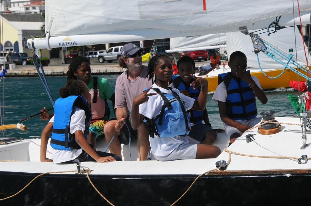 The USA's Dave Perry sails with students in the Carlos Aguilar Youth Regatta. © Dean Barnes