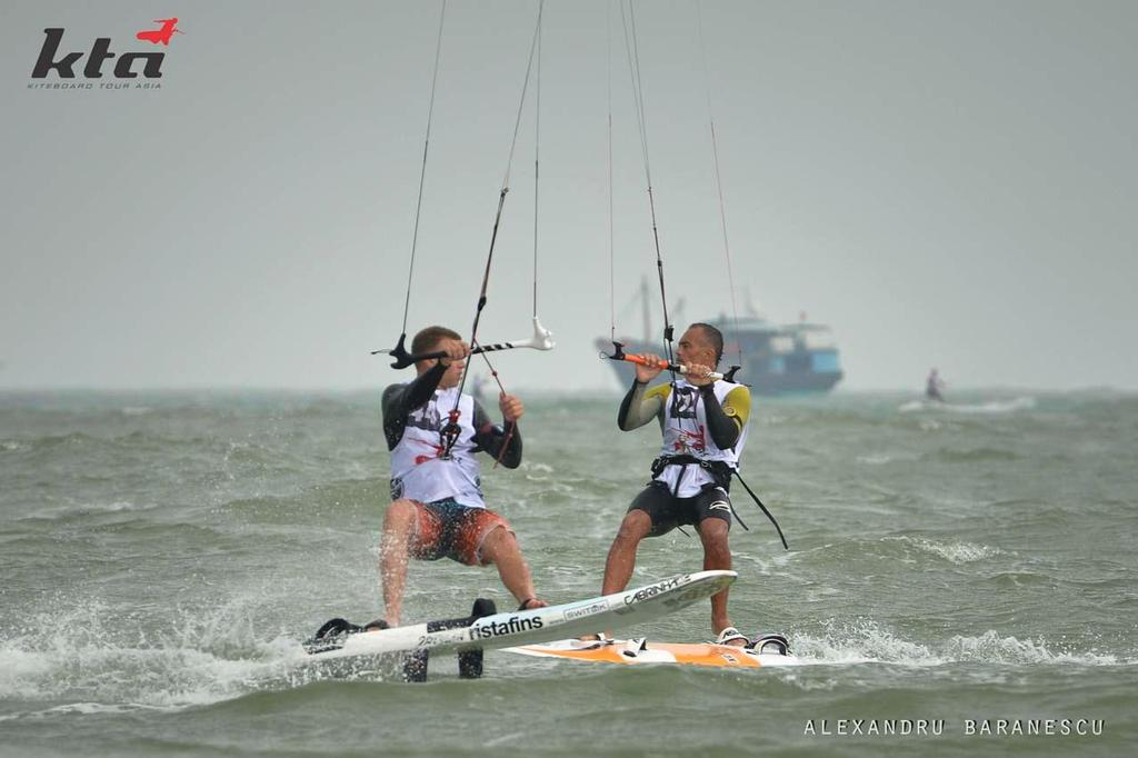 Brian Kender from Usa and Simone Vanucci from Italy in action during day two of the IKA Kiteboard Race World Championship 2013 on November 21, 2013 at King Bay Qionghai, China. © Alexandru Baranescu