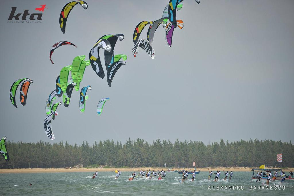 Competitors in action during day four of the IKA Kiteboard Race World Championship 2013 on November 23, 2013 at King Bay Qionghai, China. © Alexandru Baranescu