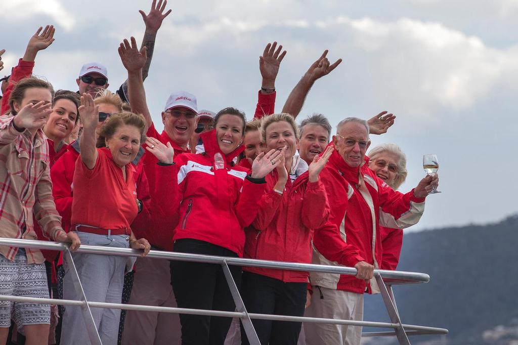 A Happy Man: Bob Oatley, with wine in hand, along with family and friends, salutes Wild Oats XI at the finish of the Rolex Sydney Hobart race 2013 © Andrea Francolini