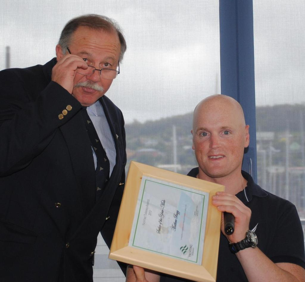 Tasmanian Sailor of the Year Matt Bugg receives his award from Yachting Tasmania president Ed Vincent © Peter Campbell